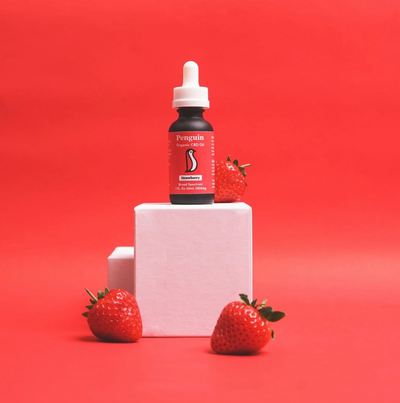 CBD strawberry oil with strawberries